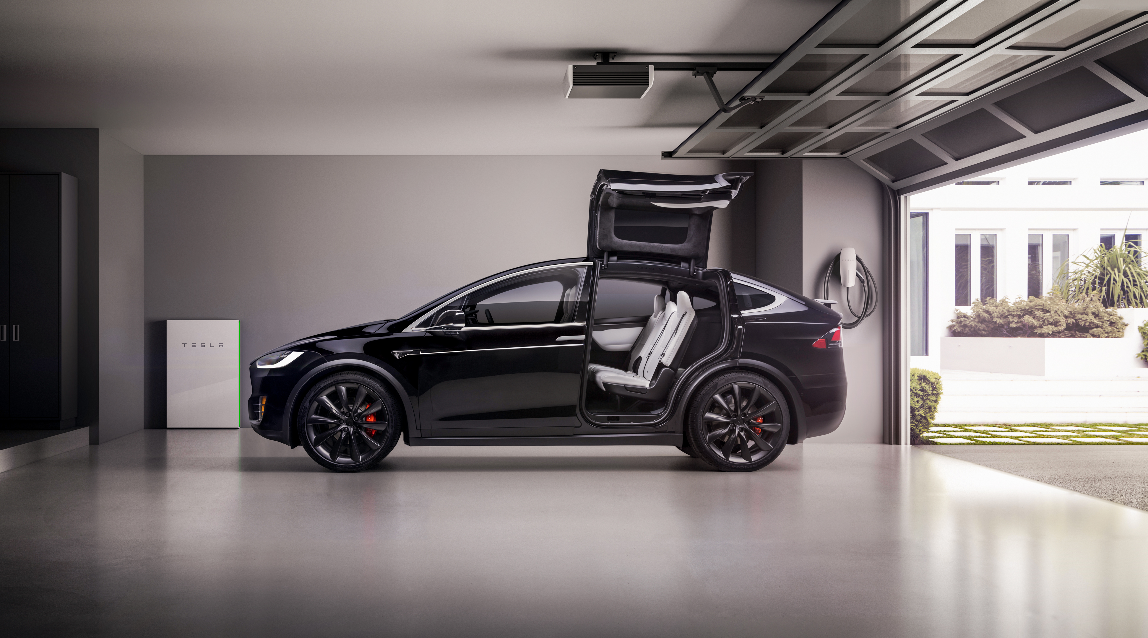 Model X in garage with wings up