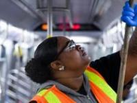 Worker cleans MTA train