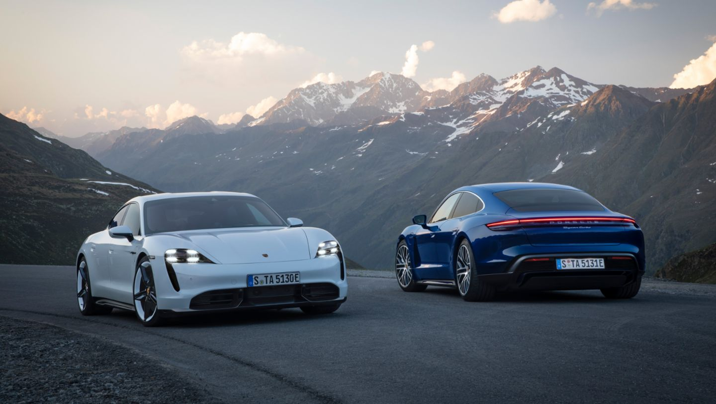 Porsche Taycan in white and another in blue
