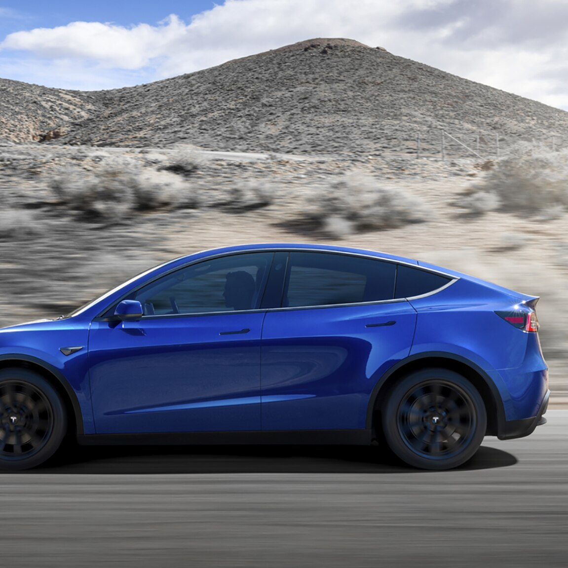 Tesla Model Y Blue Side View